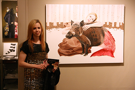 "Amy Guidry with her painting, ""Acceptance"""