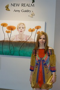 "Amy Guidry with her painting, ""Introspective"""